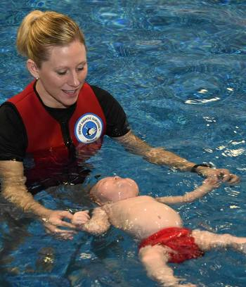 Survival Swim Instructor with Baby